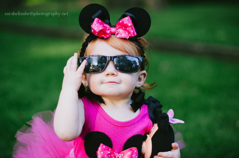 Toddler with sunglasses and Minnie Mouse