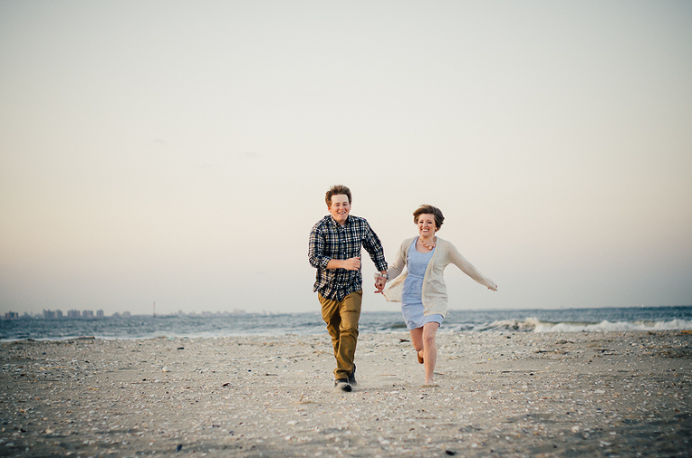 Sandy Hook Beach Sunset Engagement Session Couple running on beach